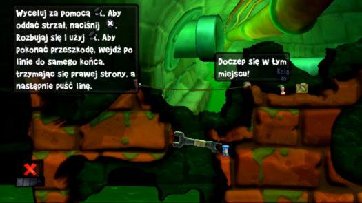 Odpowiednie miejsce do zaczepienia się w misji Szkolenie 3: Sprzęt (motyw Kanał ściekowy w grze Worms Revolution Extreme)